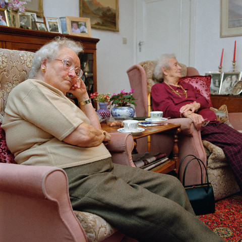 Two Old Ladies Sitting in Living Room